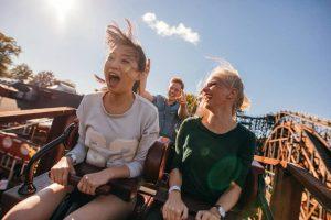 girls riding roller coaster