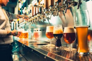 craft beers behind at the tap