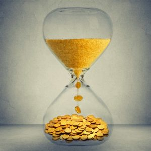 time turning to money in hourglass