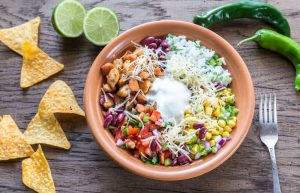 taco bowl with chips limes jalapenos