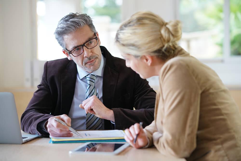 woman speaking to financial advisor