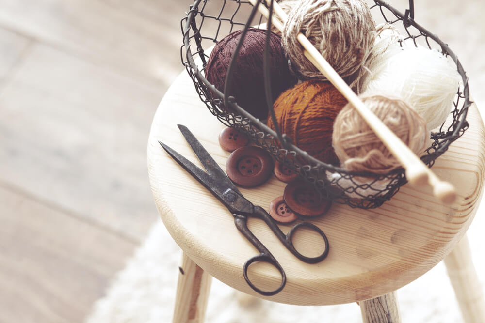 knitting room supplies on stool