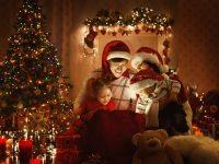 christmas family gathered around glowing bag